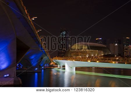 Singapore - Mar 26, 2016: Marina Bay night view. Famous buildings such as Esplanade Jubilee Bridge and Esplanade Dr Bridge were in blue green and orange liights.