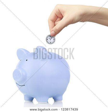 blue piggy bank and hand with coin isolated on white