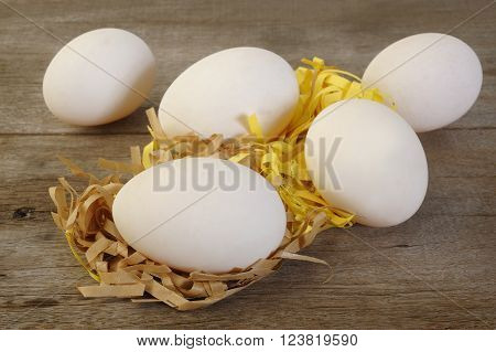 fresh duck eggs at on wooden background