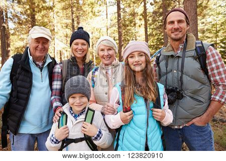 Multi generation family on forest hike, waist up portrait