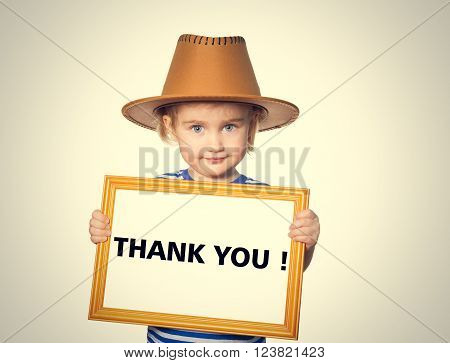 Little Funny girl in striped shirt with blackboard. Text  thank you.  Isolated on gray background
