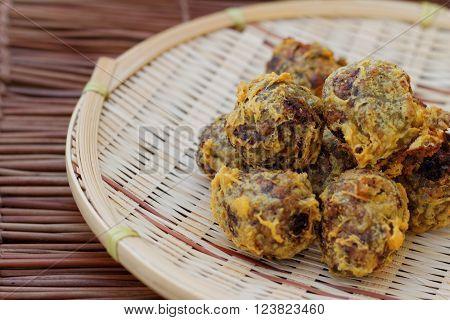 Kuih kasturi is malaysian food made from green nuts.