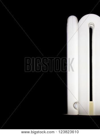 Energy saving lamp closeup on black background