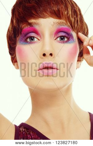 Vintage style portrait of young beautiful girl with short haircut and bright crazy disco makeup