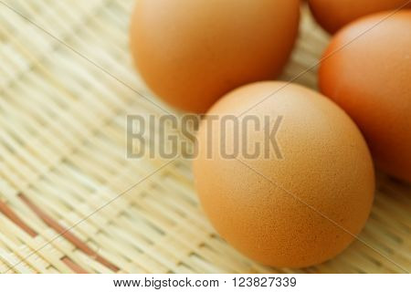 Eggs on woven rattan tray. Selected focus.
