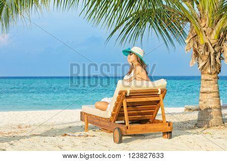 Woman relaxing on deckchair