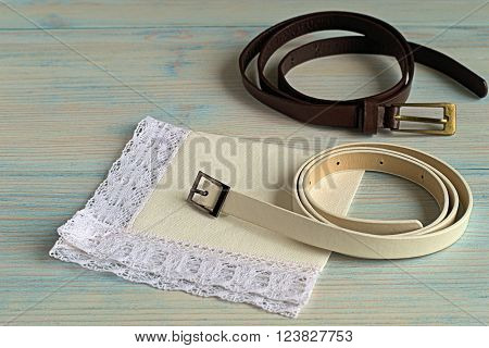 Two straps and a handkerchief on a blue wooden background