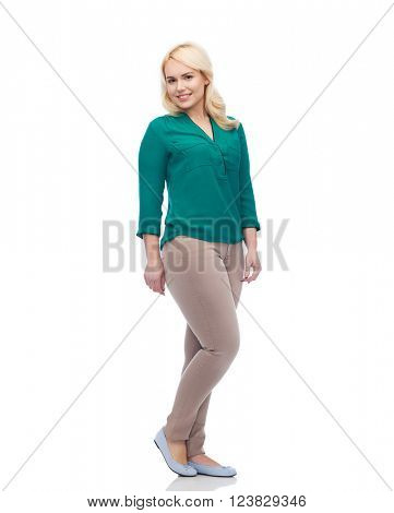 female, gender, portrait, plus size and people concept - smiling young woman in shirt and trousers