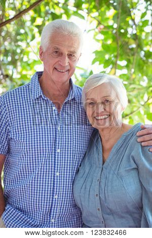 Portrait of cheerful senior couple with arm around
