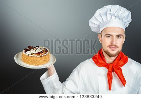 Portrait of a male confectioner cooking a delicious cake.