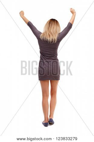 Back view of  woman raise your hands up expressing joy. Rear view people collection. backside view of person. Isolated over white background. The girl in the brown dress lifted up his fists with joy.