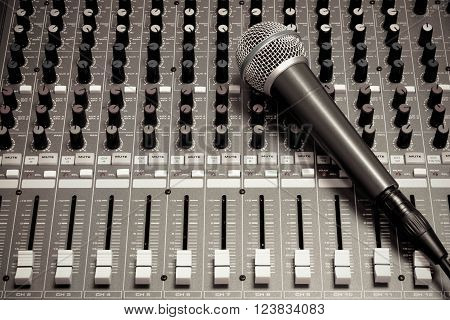 the microphone on sound music mixer background.