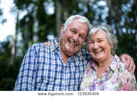 Portrait of happy senior man and woman in back yard
