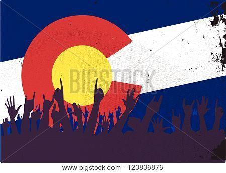 Audience happy reaction with Colorado State flag background