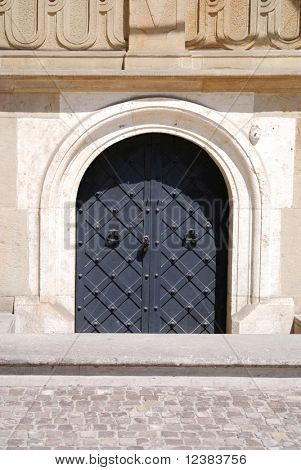 Old door with ornament in stone wall. Royal Wawel Castle, Cracow. Poland