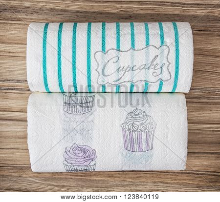 Two decorative kitchen paper towel rolls. Hygiene theme.
