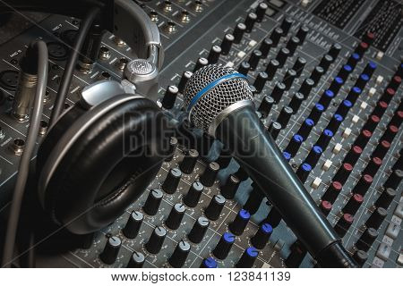 the microphone headphone and sound mixer background.