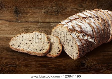 Sliced rye bread with linseed on wooden background. With clipping path