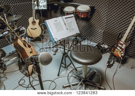 selective focus microphone and blur musical equipment guitar lyric drum piano background. ** Note: Visible grain at 100%, best at smaller sizes