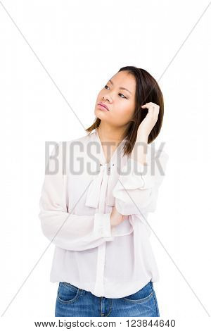 Worried young woman looking away on white background