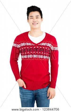 Portrait of a happy man in red pullover smiling at camera on white background
