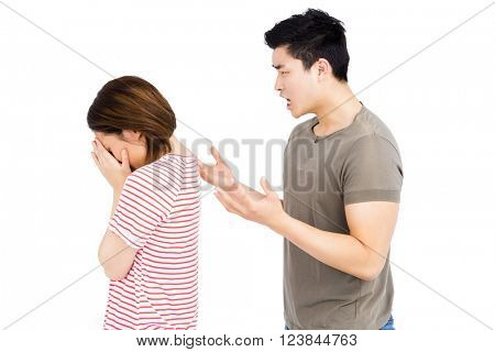 Young man and young woman into an argument on white background