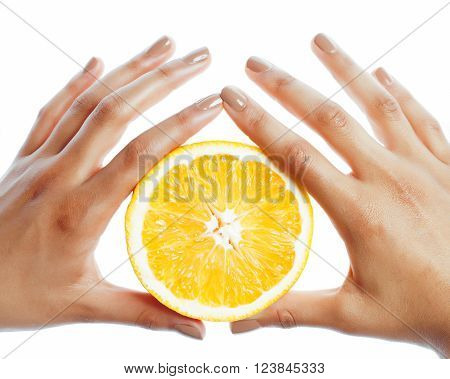 manicure pedicure on afro-american tann skin hands holding orange, healthcare concept close up