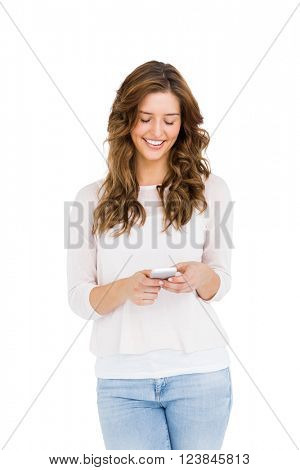 Happy young woman text messaging on mobile phone on white background