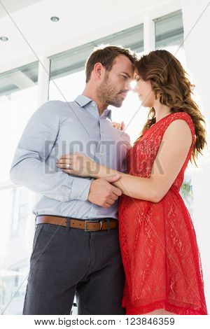 Romantic young couple looking at each other and embracing