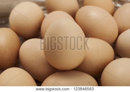 many eggs within a white- wicker basket