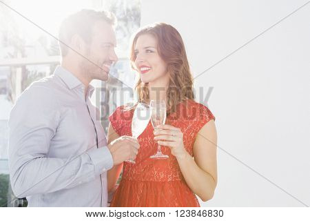 Happy young couple toasting glasses of champagne