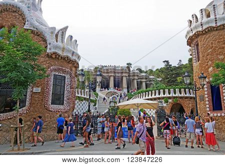 BARCELONA, SPAIN - JULY 31, 2015: View of the main entrance of the famous architectural landmark Park Guell in Barcelona, designed by renowned architect Antoni Gaudi and built between 1900 and 1914.