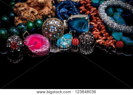 Luxury gemstone jewelry on black glossy table
