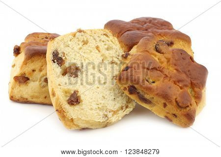 traditional english scones with raisins and a cut one on a white background
