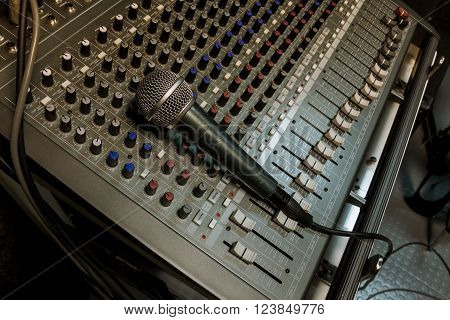microphone on the sound mixer music background.