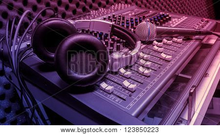 microphone headphone on sound mixer music background.