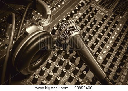 microphone headphone on sound music mixer background.