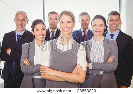 Team of businesspeople posing together in the office
