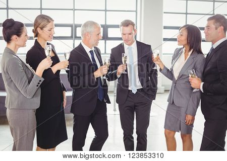 Team of businesspeople having champagne in the office