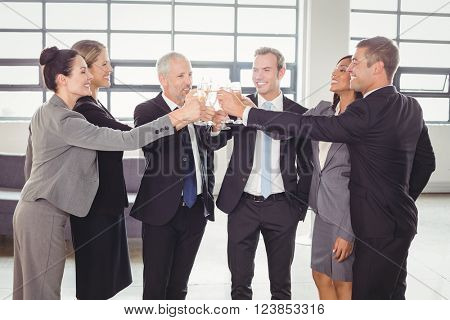 Team of businesspeople toasting champagne in the office