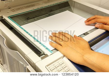 someone copy document at copy machine.non-English text mean