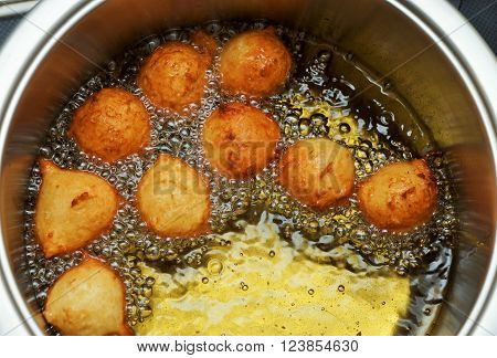 Pastry in a pot of boiling oil