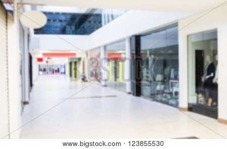 View of passage and shops in the interior of modern shopping mall