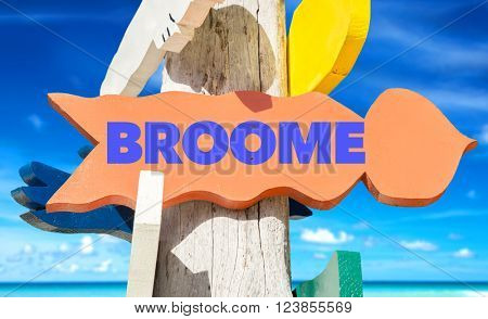 Broome signpost with beach background
