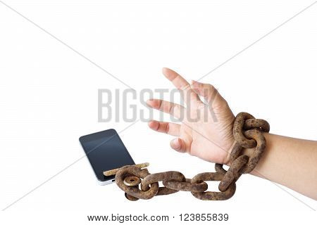 Hand tied with smart phone by big thick rusty chain in concept of addicted to smart phone, Internet and social media