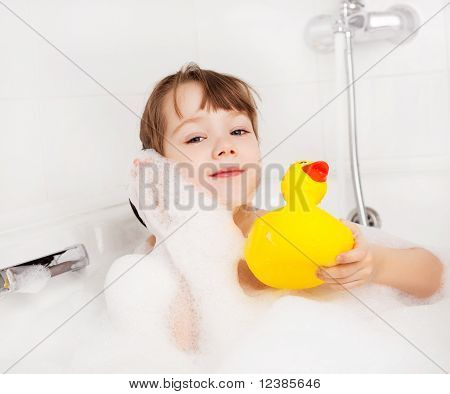 Child Taking A Bath