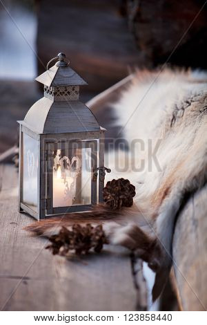 Porch decoration with lantern and reindeer fur