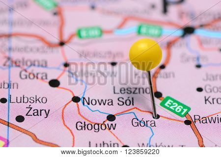 Photo of pinned Gora on a map of Poland. May be used as illustration for traveling theme.