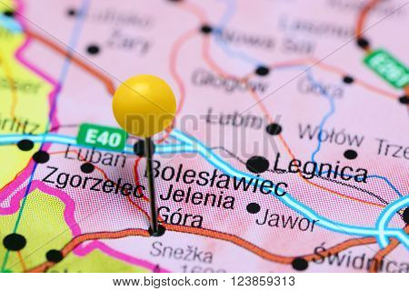 Photo of pinned Jelenia Gora on a map of Poland. May be used as illustration for traveling theme.