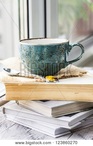 tea cup on the window sill and book ** Note: Visible grain at 100%, best at smaller sizes